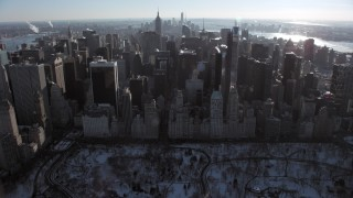 AX66_0107 - 5K stock footage aerial video tilt from Central Park to reveal Midtown Manhattan in winter, New York City