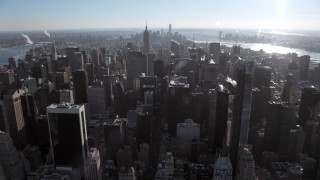 AX66_0108 - 5K stock footage aerial video of flying over Midtown Manhattan skyscrapers, New York City