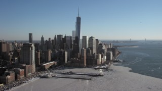 AX66_0119 - 5K stock footage aerial video of World Trade Center skyscrapers overlooking icy Hudson River, New York City