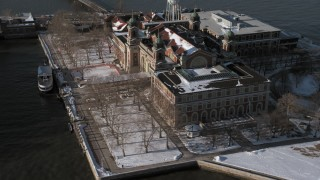 AX66_0126 - 5K stock footage aerial video of an orbit of Ellis Island buildings in snow, New York