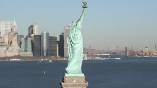 AX66_0130 - 5K stock footage aerial video of orbiting the famous Statue of Liberty on New York Harbor, New York