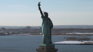 AX66_0132 - 5K stock footage aerial video of an orbit of the Statue of Liberty in winter, New York