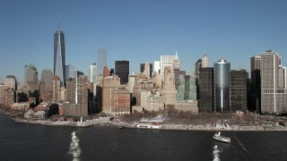 AX66_0135 - 5K stock footage aerial video approach Battery Park in snow in Lower Manhattan, New York City