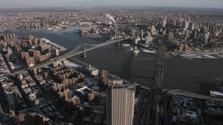 AX66_0141 - 5K stock footage aerial video orbit the Brooklyn Bridge and Manhattan Bridge, New York City
