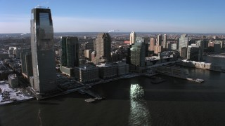 AX66_0173 - 5K stock footage aerial video of Goldman Sachs Tower and skyscrapers in Downtown Jersey City, New Jersey