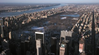 AX66_0187 - 5K stock footage aerial video an approach to Central Park in snow, New York City