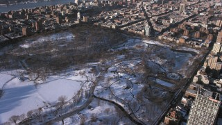 AX66_0194 - 5K stock footage aerial video of Central Park skating rink in snow, Manhattan, New York City