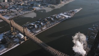 AX66_0217 - 5K stock footage aerial video of the Goldwater Specialty Hospital on Roosevelt Island with snow, East River, New York