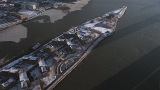 AX66_0218 - 5K stock footage aerial video of Goldwater Specialty Hospital, Roosevelt Island on East River in snow, New York City