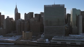 AX66_0221 - 5K stock footage aerial video of United Nations Building, Midtown Manhattan skyscrapers, New York City