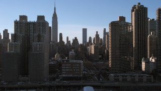 AX66_0223 - 5K stock footage aerial video of the Empire State Building and Midtown skyscrapers in winter, New York City