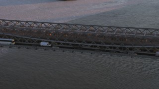 AX66_0230 - 5K stock footage aerial video approach and pan across heavy traffic on Williamsburg Bridge, New York City, sunset