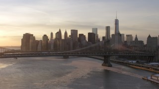AX66_0232 - 5K stock footage aerial video approach Manhattan Bridge and Lower Manhattan skyline, New York City, sunset