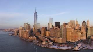 AX66_0241 - 5K stock footage aerial video of One World Trade Center and Lower Manhattan skyscrapers, New York City, sunset