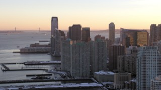 AX66_0246 - 5K stock footage aerial video of Downtown Jersey City skyscrapers, New Jersey, sunset