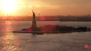 AX66_0259 - 5K stock footage aerial video of a view of the Statue of Liberty, New York City, sunset