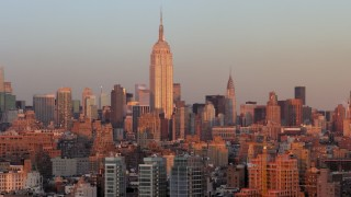 AX66_0267 - 5K stock footage aerial video of the iconic Empire State Building, Midtown Manhattan, New York City, sunset