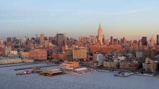 AX66_0268 - 5K stock footage aerial video of Empire State Building and Midtown Manhattan skyscrapers in New York City, sunset