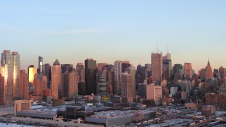 AX66_0271 - 5K stock footage aerial video of Midtown Manhattan skyscrapers in winter, New York City, sunset