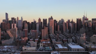 AX66_0274 - 5K stock footage aerial video of Hell's Kitchen skyscrapers in Midtown in winter, New York City, sunset