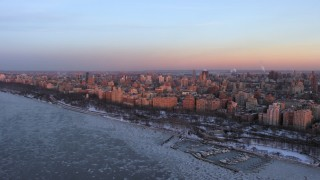 AX66_0276 - 5K stock footage aerial video of Upper West Side apartment buildings in winter, New York City twilight