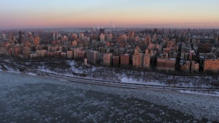 AX66_0277 - 5K stock footage aerial video of Upper West Side apartment buildings and park in winter, New York City, twilight