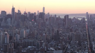 AX66_0282 - 5K stock footage aerial video tilt from Columbia University to Midtown skyscrapers in winter, New York City, twilight