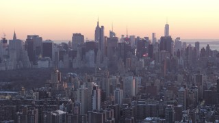 AX66_0283 - 5K stock footage aerial video tilt from Midtown skyscrapers to Columbia University in winter, New York City, twilight