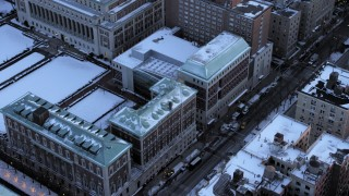 AX66_0285 - 5K stock footage aerial video fly away from Columbia University in winter, New York City, twilight