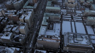 AX66_0289 - 5K stock footage aerial video tilt from Columbia University in winter, reveal Harlem, New York City, twilight