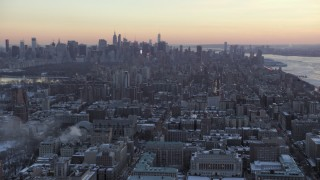 AX66_0293 - 5K stock footage aerial video tilt from Midtown to reveal Columbia University in winter, New York City, twilight