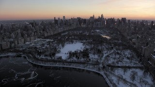 AX66_0300 - 5K stock footage aerial video of Central Park and Metropolitan Museum of Art in winter, New York City, twilight
