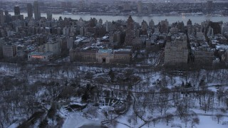 AX66_0302 - 5K stock footage aerial video of the Museum of Natural History in winter, New York City, twilight