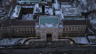 AX66_0304 - 5K stock footage aerial video of an approach to the Museum of Natural History in winter, New York City, twilight