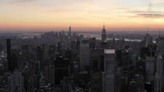 AX66_0310 - 5K stock footage aerial video of skyscrapers in Midtown Manhattan in winter, New York City, twilight