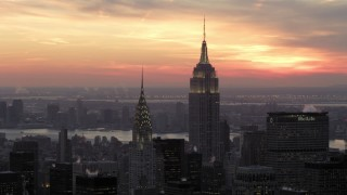 AX66_0312 - 5K stock footage aerial video of famous Empire State Building and Chrysler Building in winter, New York City, twilight