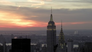 AX66_0314 - 5K stock footage aerial video flyby Empire State Building and Chrysler Building in winter, New York City, twilight