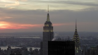 AX66_0315 - 5K stock footage aerial video orbit Empire State Building and Chrysler Building in winter, New York City, twilight