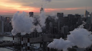 AX66_0317 - 5K stock footage aerial video of Midtown Manhattan smoke stacks and skyscrapers in winter, New York City, twilight