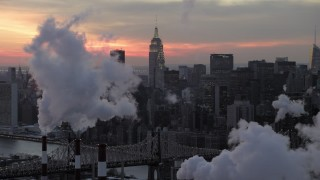 AX66_0318 - 5K stock footage aerial video of Midtown Manhattan smoke stacks and skyscrapers in winter, New York City, twilight