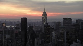 AX66_0321 - 5K stock footage aerial video approach Chrysler and Empire State Building in winter, New York City, twilight