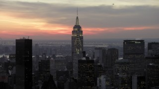 AX66_0322 - 5K stock footage aerial video fly toward Chrysler and Empire State Building in winter, New York City, twilight