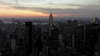 AX66_0323 - 5K stock footage aerial video approach famous Chrysler Building and Empire State Building in winter, New York City, twilight