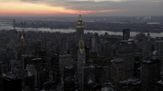 AX66_0325 - 5K stock footage aerial video of the Chrysler Building and Empire State Building in winter, New York City, twilight