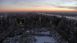 AX66_0333 - 5K stock footage aerial video of Midtown Manhattan seen from Central Park in winter, New York City, twilight