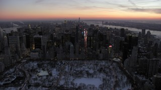 AX66_0334 - 5K stock footage aerial video approach Times Square and Midtown Manhattan in winter, New York City, twilight