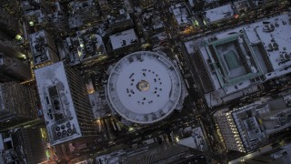 AX66_0341 - 5K stock footage aerial video of a bird's eye view of Madison Square Garden in snow, New York City, twilight