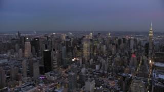 AX66_0344 - 5K stock footage aerial video of Midtown Manhattan skyscrapers in winter, New York City, twilight