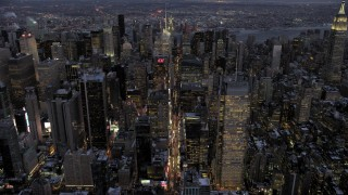 AX66_0347 - 5K stock footage aerial video of Midtown Manhattan skyscrapers in winter, New York City, twilight