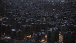 AX66_0358 - 5K stock footage aerial video of East Village apartment buildings in winter, New York City, twilight